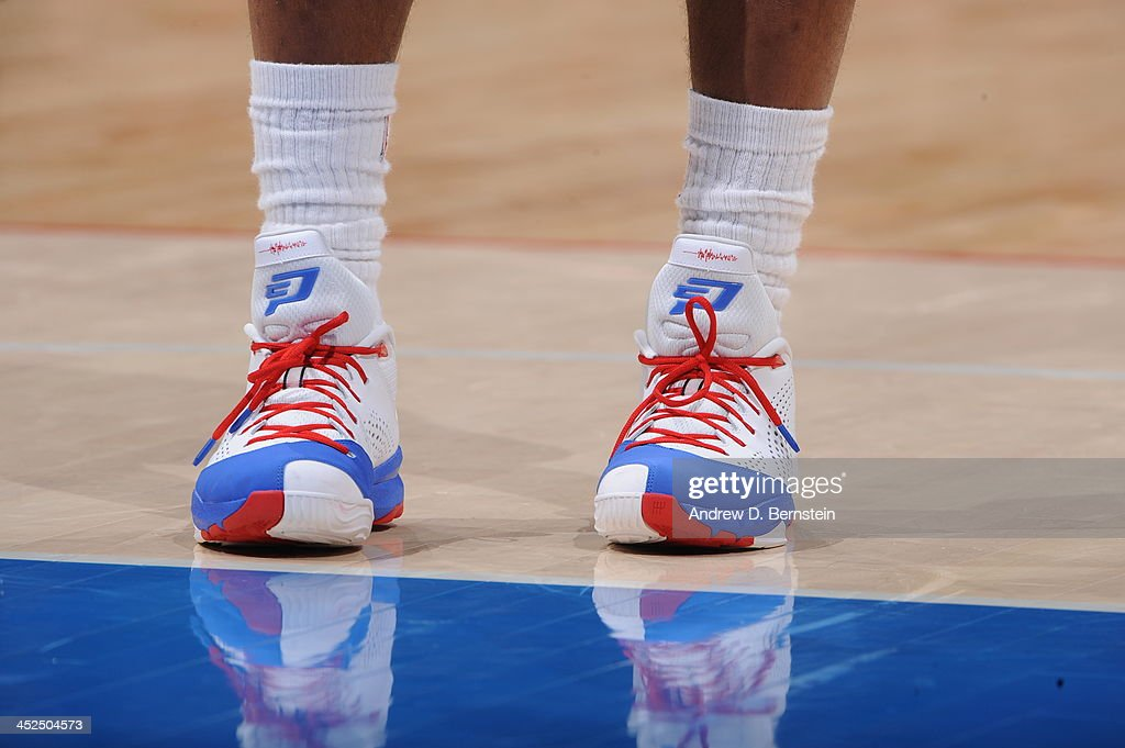 <a gi-track='captionPersonalityLinkClicked' href=/galleries/search?phrase=Chris+Paul&family=editorial&specificpeople=212762 ng-click='$event.stopPropagation()'>Chris Paul</a> #3 of the Los Angeles Clippers showcases his sneakers against the Houston Rockets at Staples Center on November 4, 2013 in Los Angeles, California.
