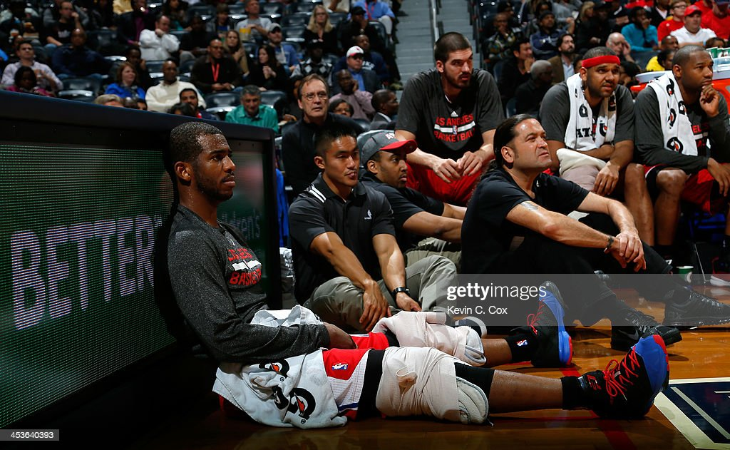 <a gi-track='captionPersonalityLinkClicked' href=/galleries/search?phrase=Chris+Paul&family=editorial&specificpeople=212762 ng-click='$event.stopPropagation()'>Chris Paul</a> #3 of the Los Angeles Clippers sits on the baseline in the first half against the Atlanta Hawks at Philips Arena on December 4, 2013 in Atlanta, Georgia.