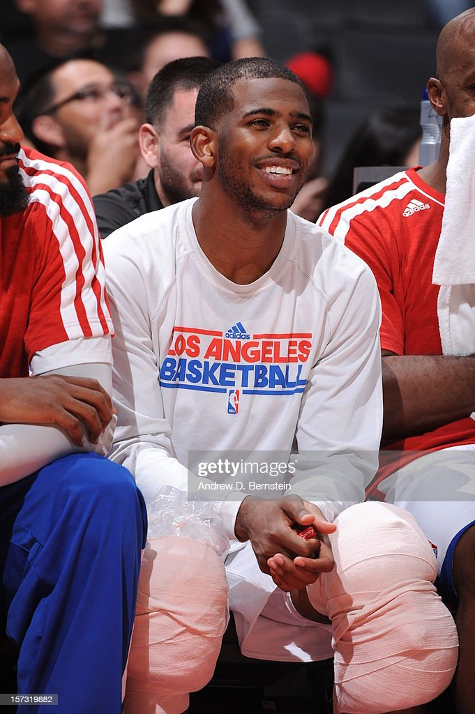Chris Paul #3 of the Los Angeles Clippers smiles from the bench during the game between the Los Angeles Clippers and the Sacramento Kings at Staples Center on December 1, 2012 in Los Angeles, California.
