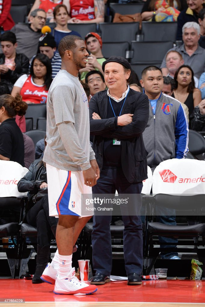 Chris Paul #3 of the Los Angeles Clippers speaks to actor Billy Crystal at halftime of a game against the Atlanta Hawks at Staples Center on March 8, 2014 in Los Angeles, California.