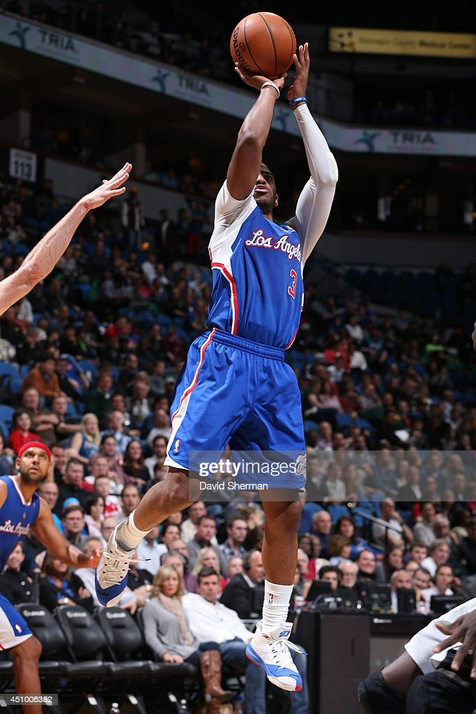 <a gi-track='captionPersonalityLinkClicked' href=/galleries/search?phrase=Chris+Paul&family=editorial&specificpeople=212762 ng-click='$event.stopPropagation()'>Chris Paul</a> #3 of the Los Angeles Clippers takes a shot against the Minnesota Timberwolves on March 31, 2014 at Target Center in Minneapolis, Minnesota.