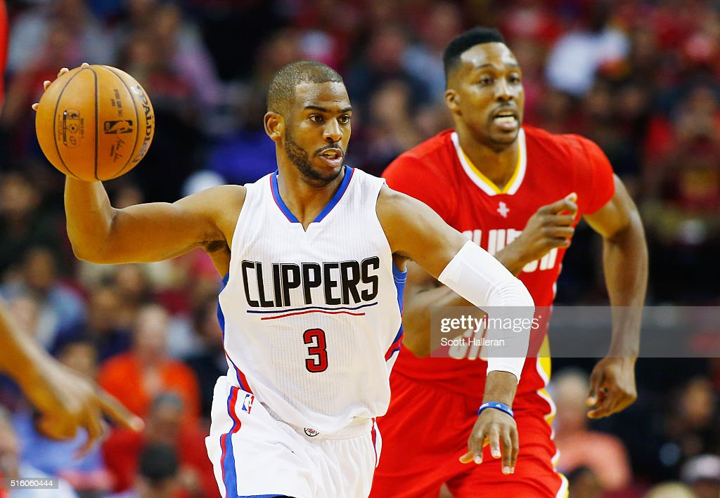 Chris Paul of the Los Angeles Clippers takes the basketball down the court in front of Dwight Howard of the Houston Rockets during their game at the...