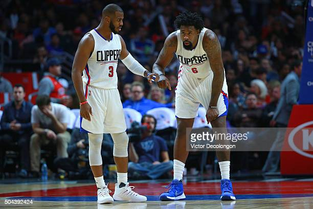 Chris Paul of the Los Angeles Clippers talks to teammate DeAndre Jordan during a free throw break in the second half of their NBA game against the...