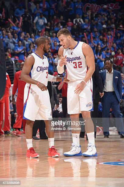 Chris Paul of the Los Angeles Clippers talks with teammate Blake Griffin against the Houston Rockets in Game Six of the Western Conference Semifinals...