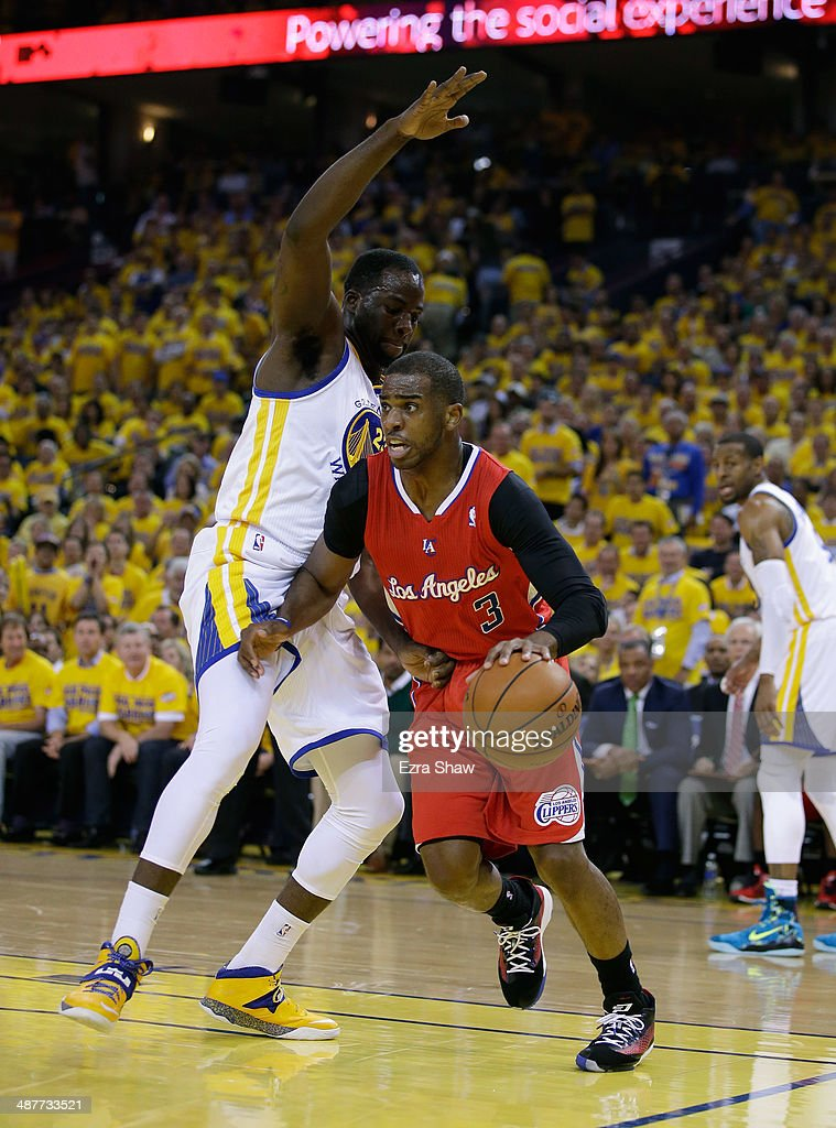 Chris Paul #3 of the Los Angeles Clippers tries to dribble past Draymond Green #23 of the Golden State Warriors in Game Six of the Western Conference Quarterfinals during the 2014 NBA Playoffs at ORACLE Arena on May 1, 2014 in Oakland, California.