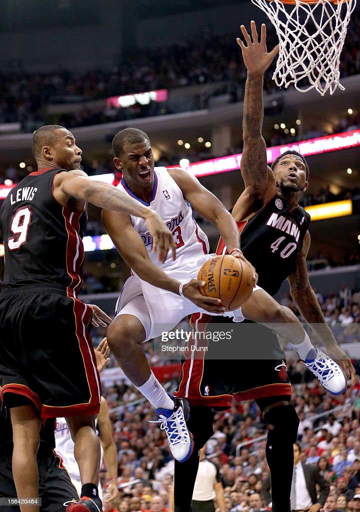 Chris Paul #3 of the Los Angeles Clippers tries to jump through Udonis Haslem #40 and Rashard Lewis #9 of the Miami Heat at Staples Center on November 14, 2012 in Los Angeles, California. The Clippers won 107-100.