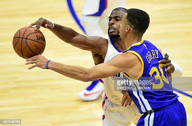 Chris Paul of the Los Angeles Clippers vies for the ball with Steph Curry of the Golden State Warriors during their NBA game in Los Angeles...
