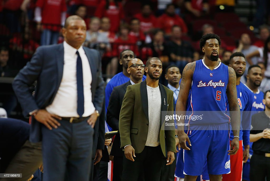 <a gi-track='captionPersonalityLinkClicked' href=/galleries/search?phrase=Chris+Paul&family=editorial&specificpeople=212762 ng-click='$event.stopPropagation()'>Chris Paul</a> #3 of the Los Angeles Clippers (C) waits alongside his coach <a gi-track='captionPersonalityLinkClicked' href=/galleries/search?phrase=Doc+Rivers&family=editorial&specificpeople=206225 ng-click='$event.stopPropagation()'>Doc Rivers</a> and <a gi-track='captionPersonalityLinkClicked' href=/galleries/search?phrase=DeAndre+Jordan&family=editorial&specificpeople=4665718 ng-click='$event.stopPropagation()'>DeAndre Jordan</a> #6 near the bench late in their game against the Houston Rockets during Game One in the Western Conference Semifinals of the 2015 NBA Playoffs on May 4, 2015 at the Toyota Center in Houston, Texas.