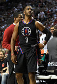 Chris Paul of the Los Angeles Clippers walks off the court after he injured his hand in the third quarter of Game Four of the Western Conference...