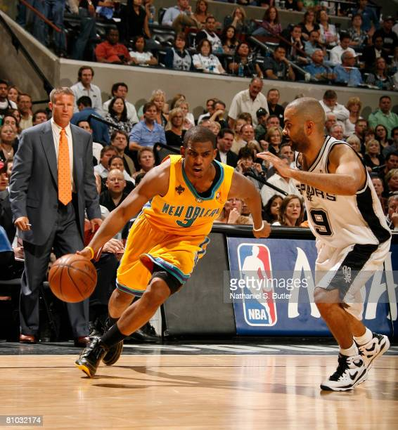 Chris Paul of the New Orleans Hornets drives against Tony Parker of the San Antonio Spurs in Game Three of the Western Conference Semifinals during...