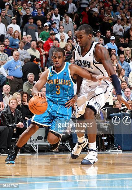 Chris Paul of the New Orleans Hornets drives to the basket against Paul Millsap of the Utah Jazz during the game at the EnergySolutions Arena on...