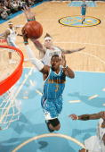 Chris Paul of the New Orleans Hornets goes to the basket against Chris Andersen of the Denver Nuggets during Game Five of the Western Conference...