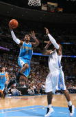 Chris Paul of the New Orleans Hornets goes to the basket against the Denver Nuggets during Game Five of the Western Conference Quarterfinals during...