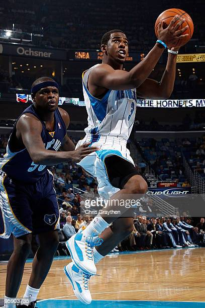 Chris Paul of the New Orleans Hornets goes up for a shot against Zach Randolph of the Memphis Grizzlies at the New Orleans Arena on January 20 2010...
