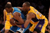 Chris Paul of the New Orleans Hornets holds the ball as Kobe Bryant of the Los Angeles Lakers goes after it from behind in the second quarter in Game...
