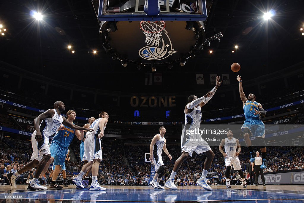 <a gi-track='captionPersonalityLinkClicked' href=/galleries/search?phrase=Chris+Paul&family=editorial&specificpeople=212762 ng-click='$event.stopPropagation()'>Chris Paul</a> #3 of the New Orleans Hornets shoots against <a gi-track='captionPersonalityLinkClicked' href=/galleries/search?phrase=Dwight+Howard&family=editorial&specificpeople=201570 ng-click='$event.stopPropagation()'>Dwight Howard</a> #12 of the Orlando Magic during the game on February 11, 2011 at the Amway Center in Orlando, Florida.