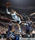 Chris Paul of the New Orleans Hornets shoots over Jason Terry Erick Dampier and Josh Howard of the Dallas Mavericks on April 12 2009 at the New...