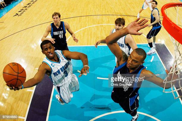 Chris Paul of the New Orleans Hornets shoots the ball over Caron Butler of the Dallas Mavericks at the New Orleans Arena on March 22 2010 in New...