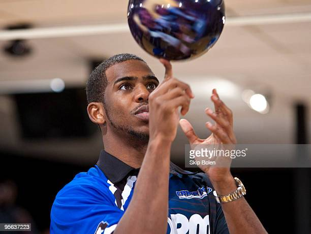 Chris Paul of the New Orleans Hornets spins a bowling ball on his finger at the PBA celebrity bowling fundraiser at Riverboat Lanes on January 7 2010...