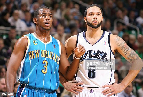 Chris Paul of the New Orleans Hornets stands next to Deron Williams of the Utah Jazz during the game at the EnergySolutions Arena on January 04 2010...
