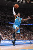 Chris Paul of the New Orleans Hornets takes the ball to the basket against the Denver Nuggets in Game Five of the Western Conference Quarterfinals...