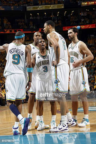 Chris Paul of the New Orleans Hornets talks to teammates Morris Peterson David West Tyson Chandler and Peja Stojakovic during their match against the...