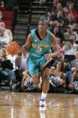 Chris Paul of the New Orleans/Oklahoma City Hornets dribbles the ball against the Portland Trail Blazers on Febuary 26 2006 at the Rose Garden Arena...