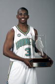 Chris Paul of the New Orleans/Oklahoma City Hornets poses with the Eddie Gottlieb Trophy after being named the 2006 NBA Rookie of the Year on May 10...