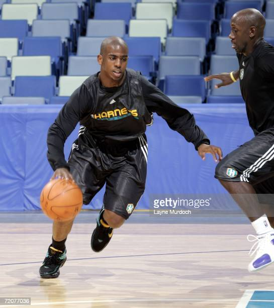 Chris Paul of the New Orleans/Oklahoma City Hornets runs a drill against teammate Bobby Jackson during opening day of NBA training camp on October 3...