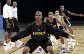 Chris Paul of the New Orleans/Oklahoma City Hornets runs drills with teammates during opening day of NBA training camp on October 3 2006 at the New...