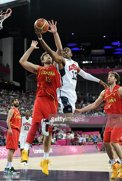 Chris Paul of the United States takes the ball to the basket past Marc Gasol of Spain during the Men's Basketball gold medal game between the United...