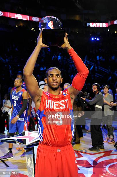 Chris Paul of the Western Conference AllStars celebrates winning the MVP by holding up his trophy after the 2013 NBA AllStar Game presented by Kia on...