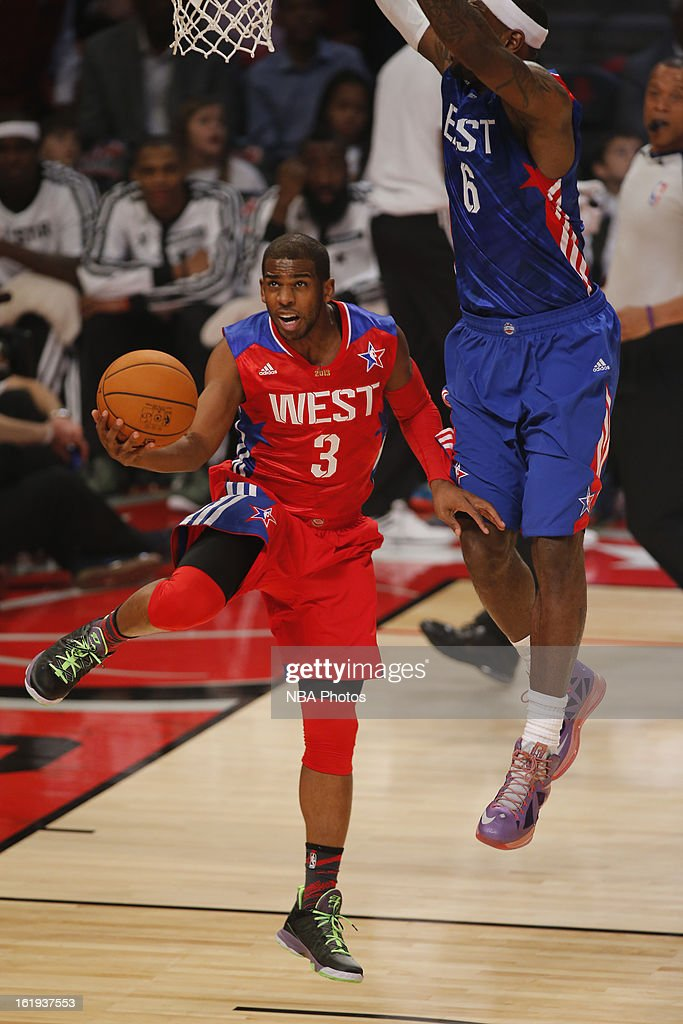 Chris Paul #3 of the Western Conference All-Stars goes up for the reverse layup against LeBron James #6 of the Eastern Conference All-Stars during 2013 NBA All-Star Game on February 17, 2013 at Toyota Center in Houston, Texas.