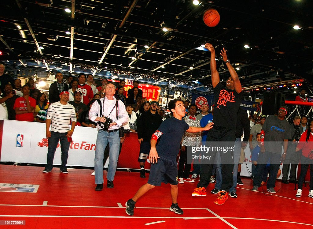 Chris Paul plays one-on-one with a lucky fan during an appearance in the State Farm Skills Court in Jam Session during NBA All Star Weekend on February 15, 2013 in the George R. Brown Convention Center in Houston, Texas.