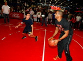 Chris Paul plays oneonone with a lucky fan during an appearance in the State Farm Skills Court in Jam Session during NBA All Star Weekend on February...