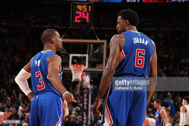 Chris Paul talks with DeAndre Jordan of the Los Angeles Clippers during the game against the New York Knicks on March 25 2015 at Madison Square...