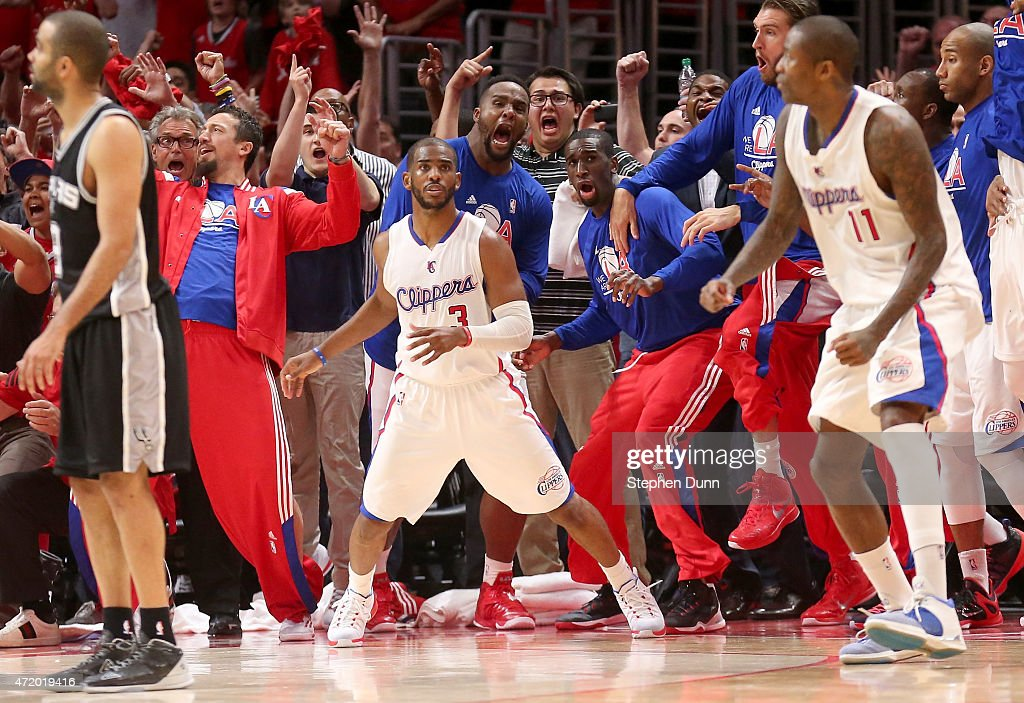 Chris Paul #3 the Los Angeles Clippers and the Clippers bench react after Paul made a basket with one second remaining to give the Clippers the win against the San Antonio Spurs during Game Seven of the Western Conference quarterfinals of the 2015 NBA Playoffs at Staples Center on May 2, 2015 in Los Angeles, California. The Clippers won 111-109 to win the series four games to three.