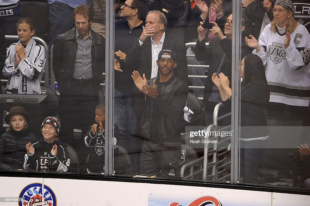 Chris Paul watches the game between the Los Angeles Kings and the Chicago Blackhawks in Game Six of the Western Conference Final during the 2014 Stanley Cup Playoffs at Staples Center on May 30, 2014 in Los Angeles, California.