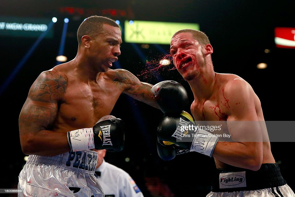 Chris Pearson connects with a left to the face of Joshua Williams during their middleweight fight at the MGM Grand Garden Arena on September 14, 2013 in Las Vegas, Nevada.