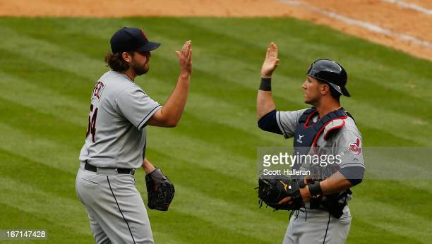 Chris Perez and Yan Gomes of the Cleveland Indians celebrate defeating the Houston Astros 54 at Minute Maid Park on April 21 2013 in Houston Texas