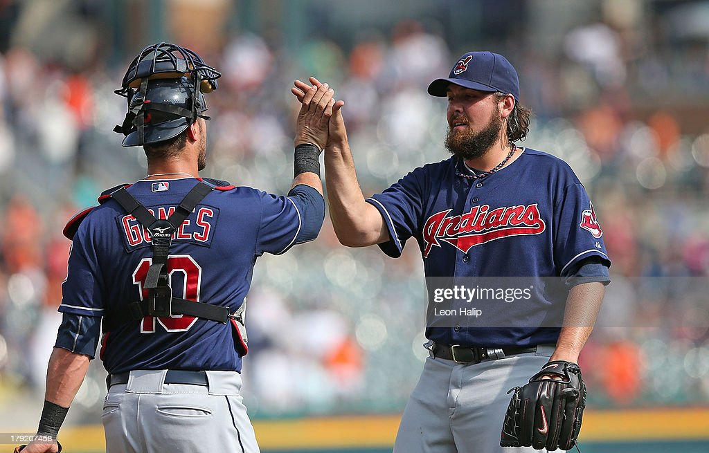 Chris Perez #54 of the Cleveland Indians celebrates with teammate <a gi-track='captionPersonalityLinkClicked' href=/galleries/search?phrase=Yan+Gomes&family=editorial&specificpeople=9004037 ng-click='$event.stopPropagation()'>Yan Gomes</a> #10 after defeating the Detroit Tigers at Comerica Park on September 1, 2013 in Detroit, Michigan. The Indians defeated the Tigers 4-0.