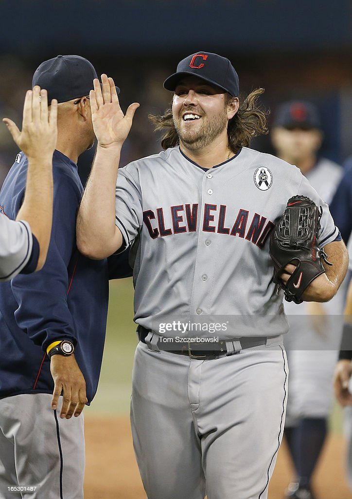 Chris Perez #54 of the Cleveland Indians celebrates with teammates during MLB game action on Opening Day after defeating the Toronto Blue Jays on April 2, 2013 at Rogers Centre in Toronto, Ontario, Canada.
