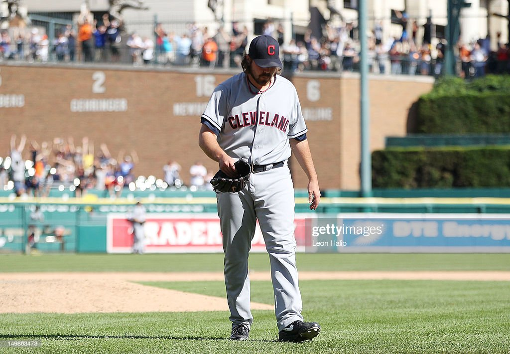 Chris Perez #54 of the Cleveland Indians walks off the field after giving up a tenth inning game winning home run to Miguel Cabrera #24 of the Detroit Tigers scoring Omar Infante #4 at Comerica Park on August 5, 2012 in Detroit, Michigan. The Tigers defeated the Indians 10-8.
