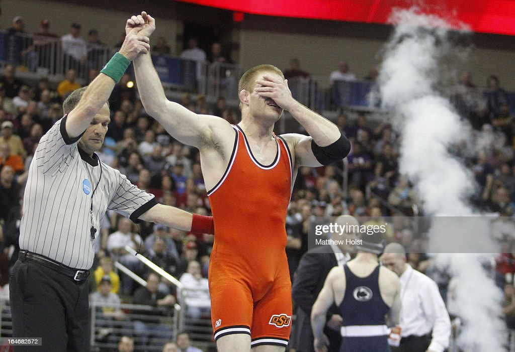 Chris Perry of the Oklahoma State Cowboys reacts after defeating Matthew Brown of the Penn State Nittany Lions in the 174-pound championship match at the 2013 NCAA Wrestling Championships on March 23, 2013 at Wells Fargo Arena in Des Moines, Iowa.