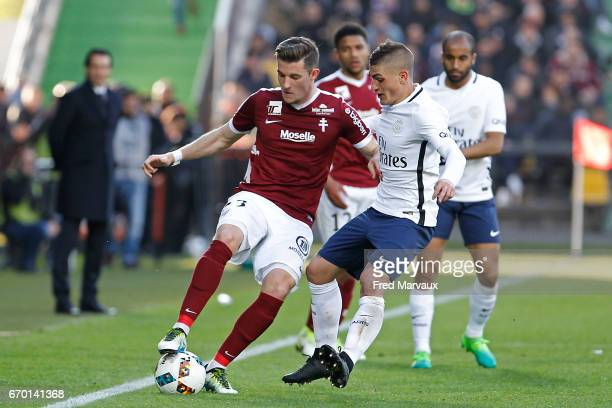 Chris Philipps of Metz and Marco Verratti of PSG during the Ligue 1 match between Fc Metz and Paris SaintGermain at Stade SaintSymphorien on April 18...