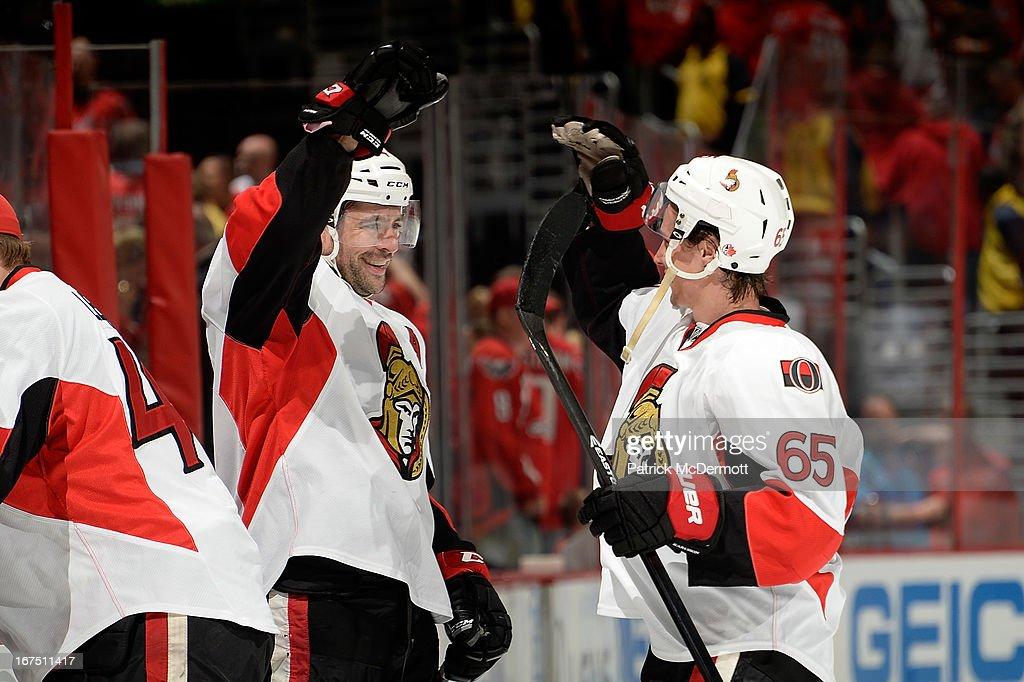 Chris Phillips #4 (Left) and <a gi-track='captionPersonalityLinkClicked' href=/galleries/search?phrase=Erik+Karlsson&family=editorial&specificpeople=5370939 ng-click='$event.stopPropagation()'>Erik Karlsson</a> #65 (right) of the Ottawa Senators celebrate after defeating the Washington Capitals 2-1 in overtime at Verizon Center on April 25, 2013 in Washington, DC.