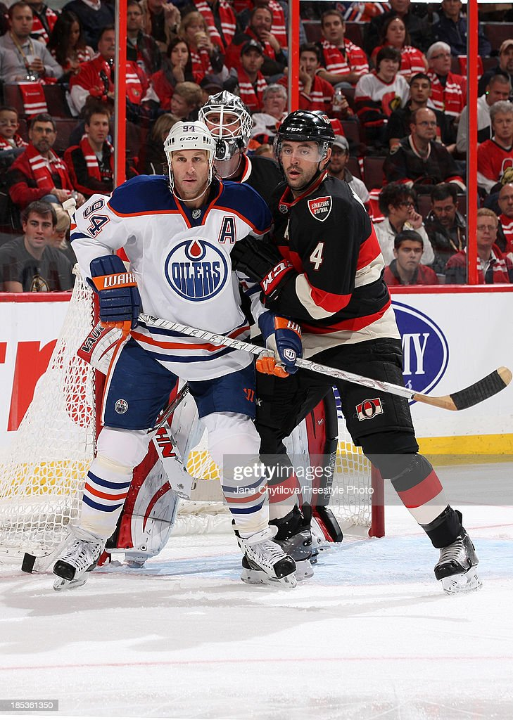 Chris Phillips #4 and <a gi-track='captionPersonalityLinkClicked' href=/galleries/search?phrase=Robin+Lehner&family=editorial&specificpeople=5894610 ng-click='$event.stopPropagation()'>Robin Lehner</a> #40 of the Ottawa Senators defend the nets against <a gi-track='captionPersonalityLinkClicked' href=/galleries/search?phrase=Ryan+Smyth+-+Ice+Hockey+Player&family=editorial&specificpeople=202567 ng-click='$event.stopPropagation()'>Ryan Smyth</a> #94 of the Edmonton Oilers during an NHL game at Canadian Tire Centre on October 19, 2012 in Ottawa, Ontario, Canada.