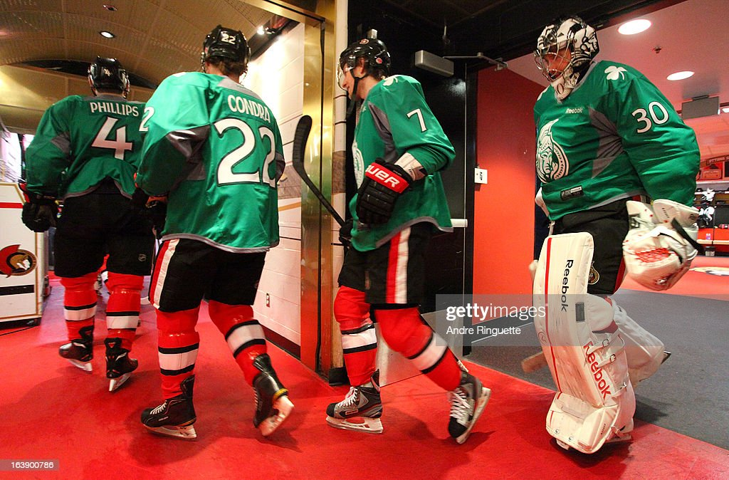 Chris Phillips #4, Erik Condra #22, Kyle Turris #7 and Ben Bishop #30 of the Ottawa Senators walk out to warm up wearing special green jerseys for St. Patrick's Day prior to a game against the Winnipeg Jets on March 17, 2013 at Scotiabank Place in Ottawa, Ontario, Canada.