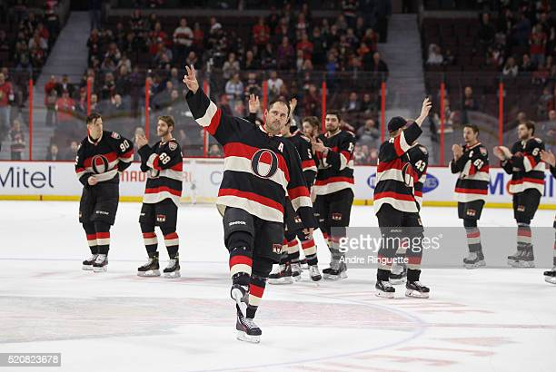 Chris Phillips of Ottawa Senators waves to the crowd on Fan Appreciate night after the last home game of the season against the Florida Panthers at...