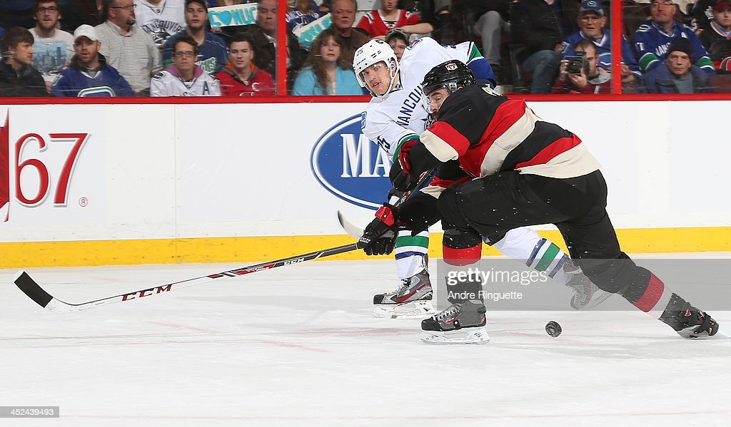 Chris Phillips #4 of the Ottawa Senators blocks a shot attempted by <a gi-track='captionPersonalityLinkClicked' href=/galleries/search?phrase=Mike+Santorelli&family=editorial&specificpeople=4517042 ng-click='$event.stopPropagation()'>Mike Santorelli</a> #25 of the Vancouver Canucks at Canadian Tire Centre on November 28, 2013 in Ottawa, Ontario, Canada.